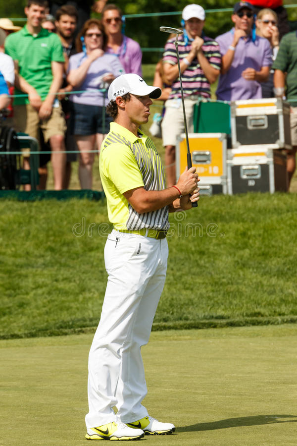 Rory McIlroy at the Memorial Tournament. Rory McIlroy on the 18th green at the 2014 Memorial Tournament stock photos