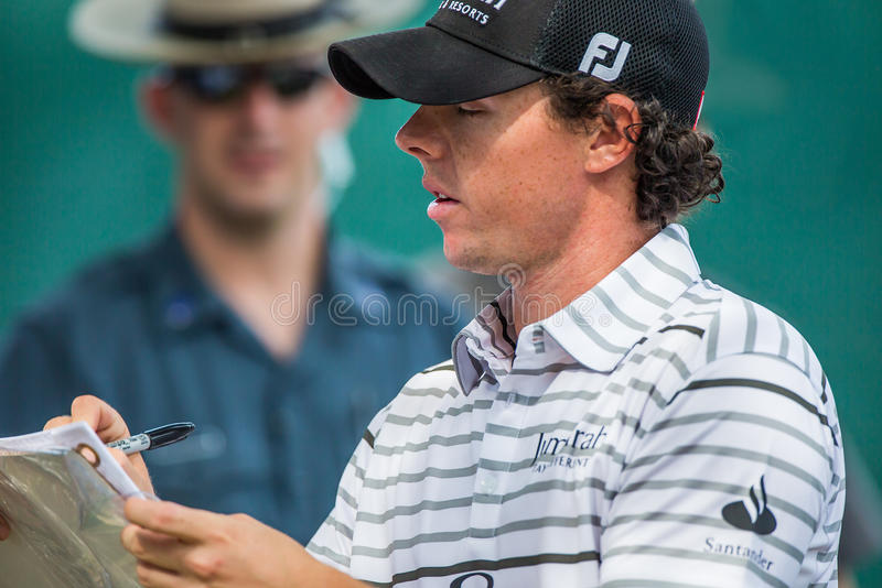 Rory McIlroy signs autographs at the 2012 Barclays. FARMINGDALE, NY - AUGUST 21: Rory McIlroy signs autographs at Bethpage Black during the Barclays on August 21 stock photography