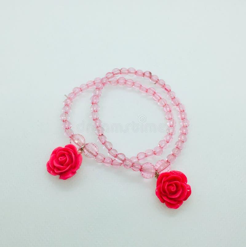 Rosa armband arkivfoton