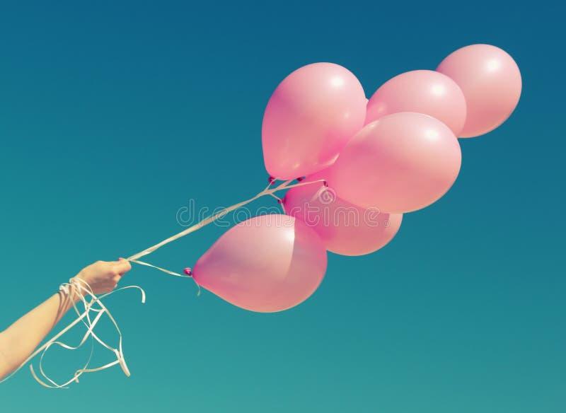 Rosa ballonger arkivbilder