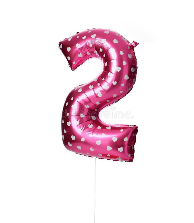 Rosa de dos dígitos rosado enorme del globo con los corazones como presente para la fiesta de cumpleaños fotografía de archivo