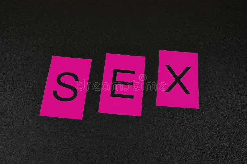 ` Rosa del sesso del ` di parola sui precedenti neri Parola dalle lettere isolate immagini stock libere da diritti