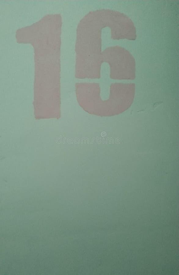 Rosa der Nr. 16 auf einem blauen Hintergrund simbol lizenzfreies stockbild