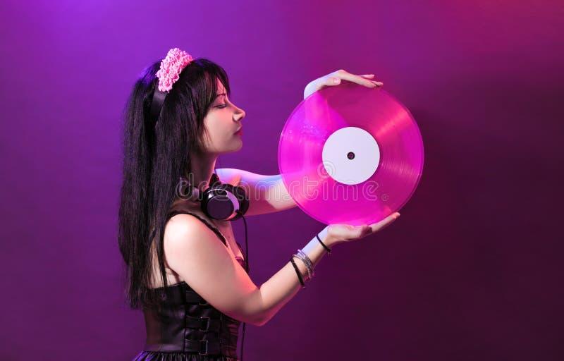 Rosa di plastica di retro del miscelatore del partito della ragazza della discoteca dell'attrezzatura della cuffia del DJ della g fotografia stock