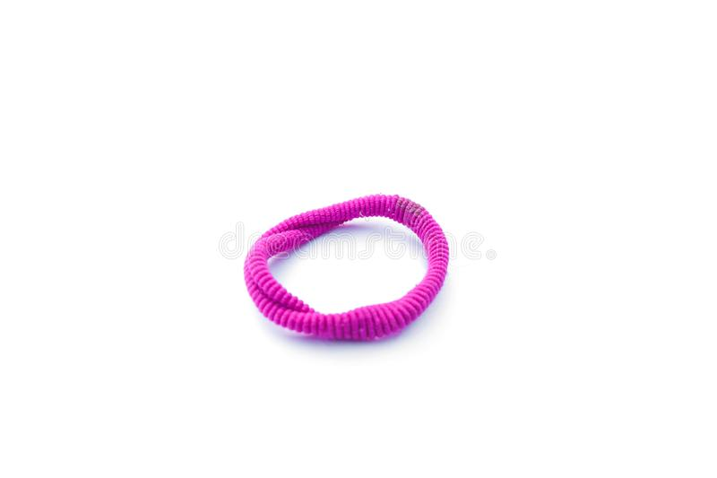 rosa elastisches Haarband isoliert auf weißem Hintergrund lizenzfreie stockfotos