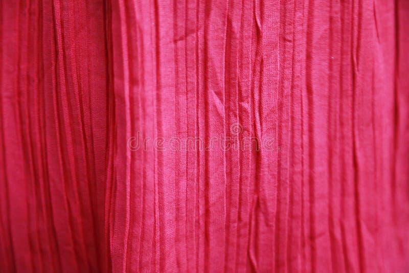 Rosa färger skrynklig tygbakgrund arkivfoto