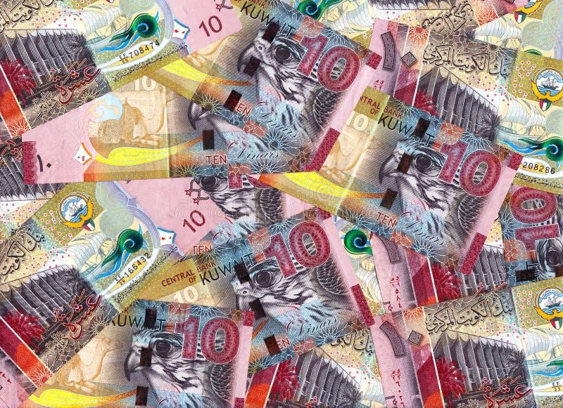 Rosa färger tio dinar Kuwait sedlar blandade in i en finansiella Backdr royaltyfri fotografi