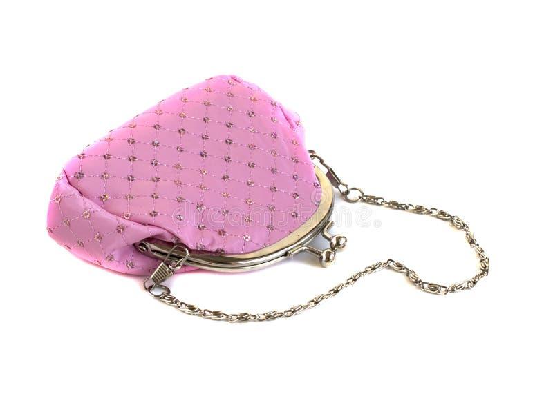 Rosa färghandväskan med kedjar royaltyfri bild