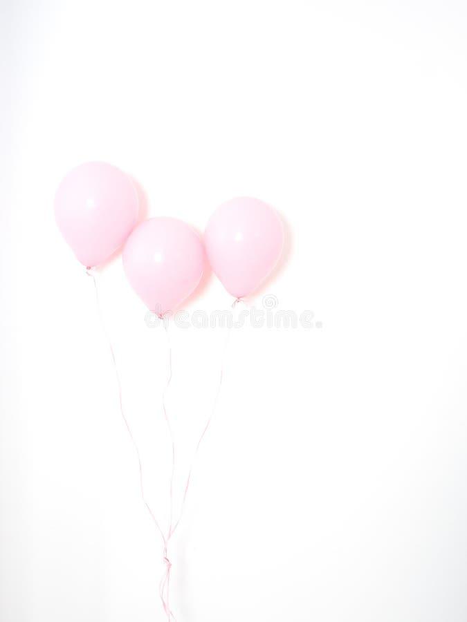 Rosa färgpastell för ballong på grå färger royaltyfria foton