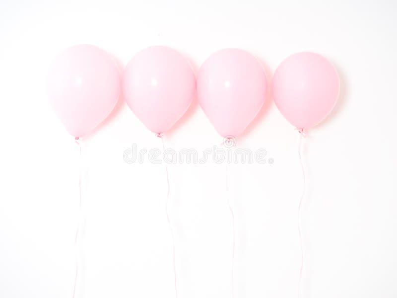 Rosa färgpastell för ballong på grå färger fotografering för bildbyråer