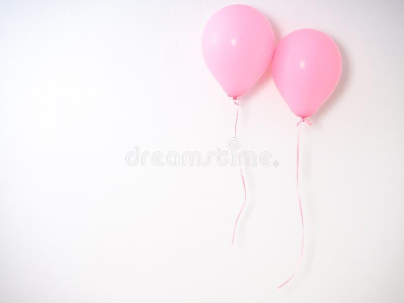 Rosa färgpastell för ballong på grå färger arkivfoto