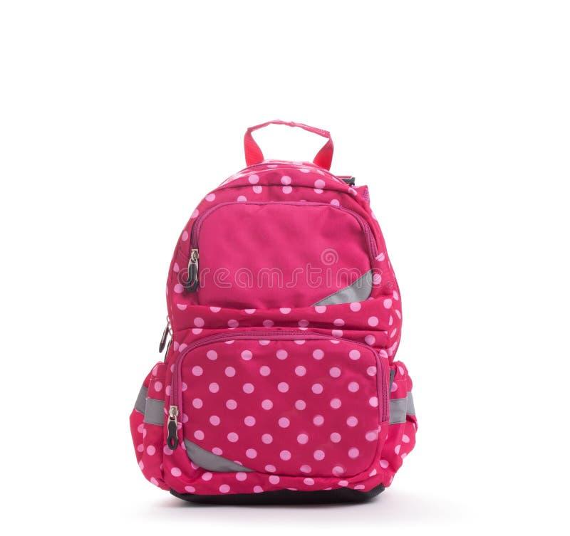 Rosa färgskolaryggsäck med vitprickar som isoleras på vit royaltyfri foto