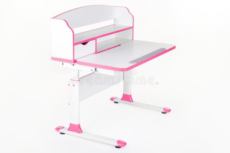 Rosa färgskolaskrivbord royaltyfri foto