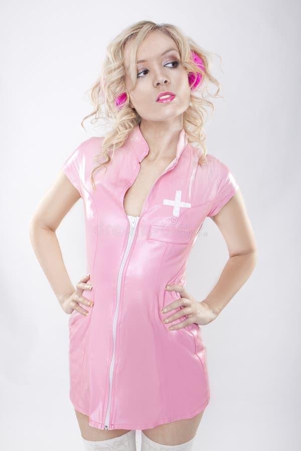 rosa förföriskt för sjuksköterska royaltyfri foto