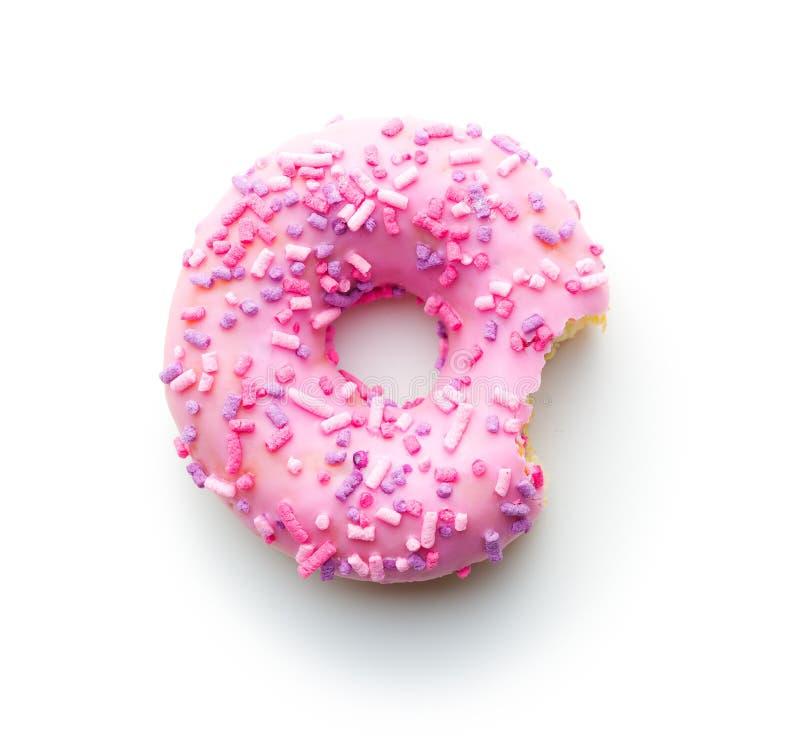 Rosa gebissener Donut lizenzfreie stockfotos