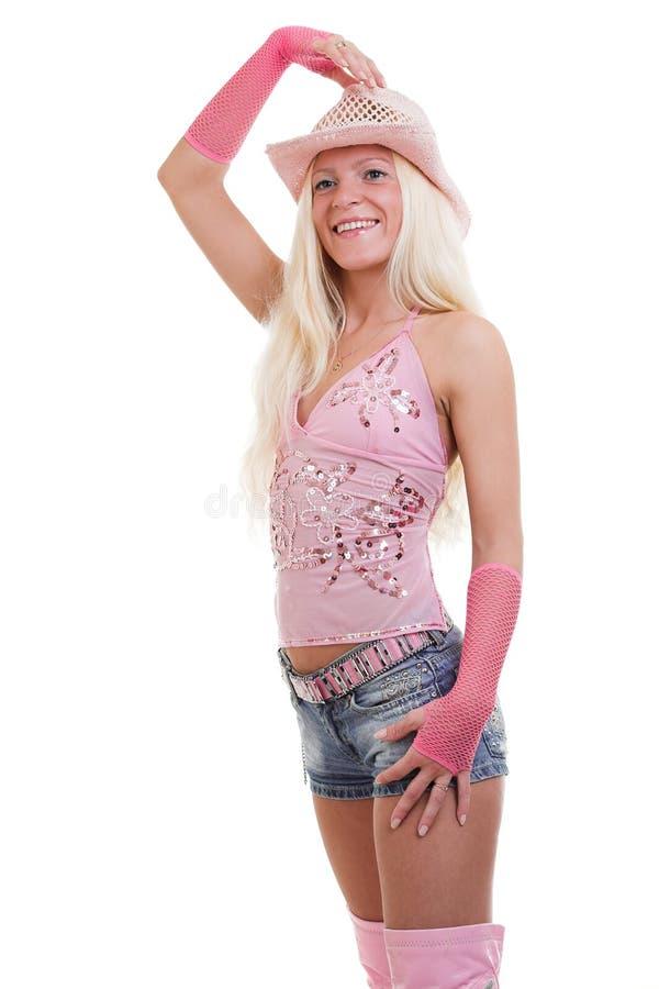 Rosa gekleidetes blondes lizenzfreie stockfotografie