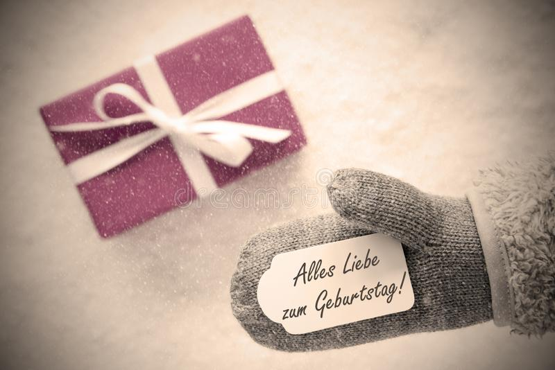 Rosa Geschenk, Handschuh, Geburtstag bedeutet alles Gute zum Geburtstag, Instagram-Filter stockbild