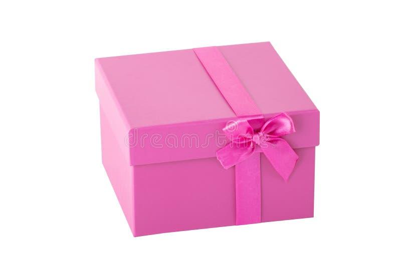 Rosa Geschenkbox mit dem rosa Bandbogen lokalisiert auf einem weißen backgroun lizenzfreie stockbilder