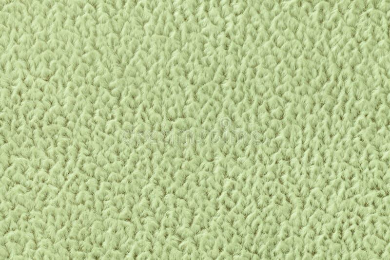 Rosa grüner Hintergrund des weichen, wolligen Stoffes Beschaffenheit der Textilnahaufnahme lizenzfreie stockfotos