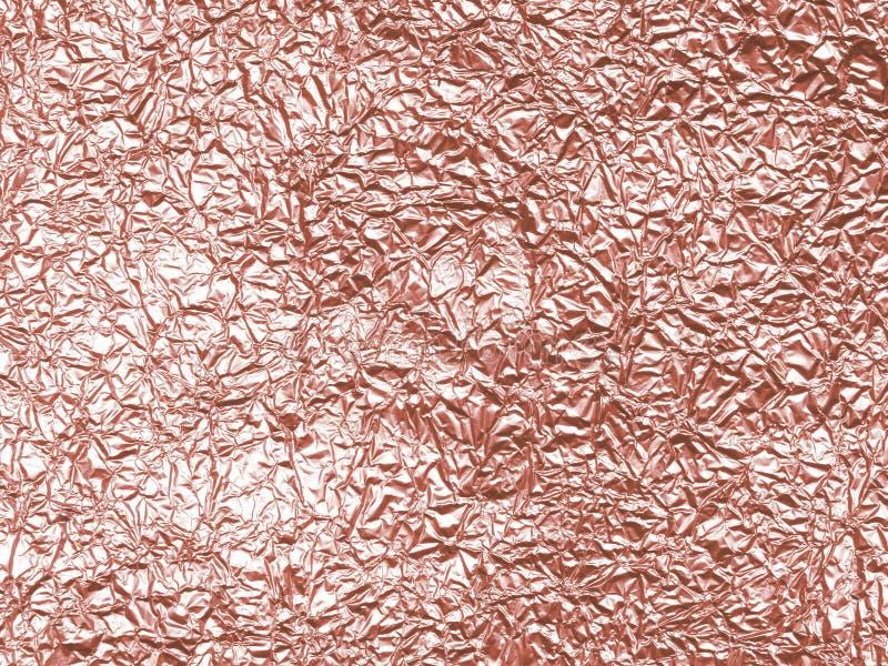 Rosa guld - foliebakgrundstextur royaltyfria foton