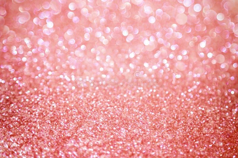 Rosa guld- skinande bakgrund arkivbilder