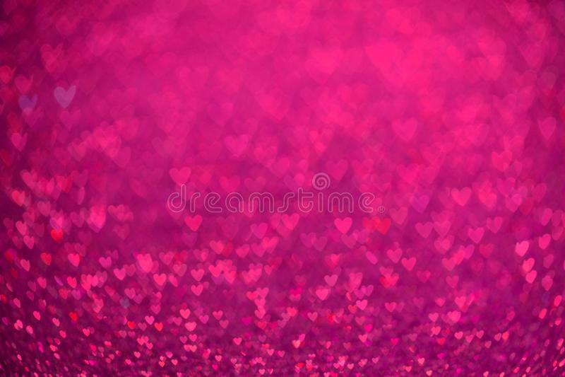 Rosa hjärtabokehbakgrund Valentindagtextur royaltyfri foto