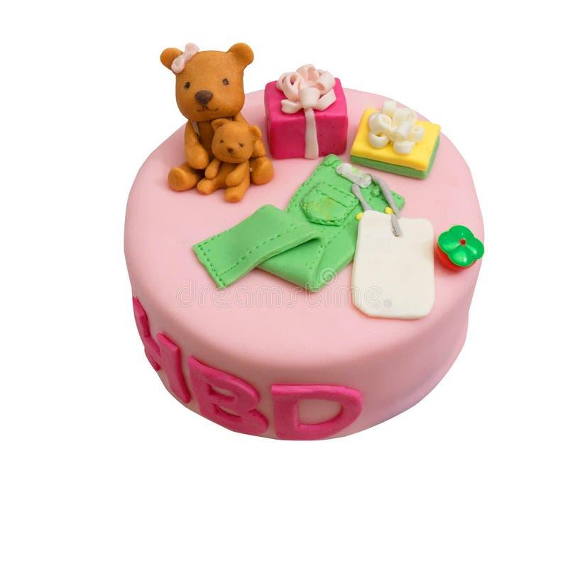Rosa Kuchen mit Braunbärpräsentkartonbaumwollstoff keucht auf weißem backgr stockbilder
