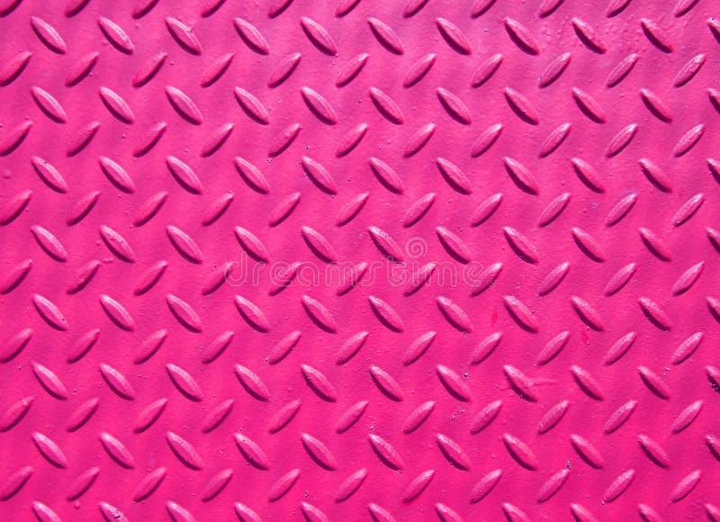 Rosa malte das industrielle Stahlbedecken mit strukturiertem Bodenbelagmuster des Gitters lizenzfreie stockbilder