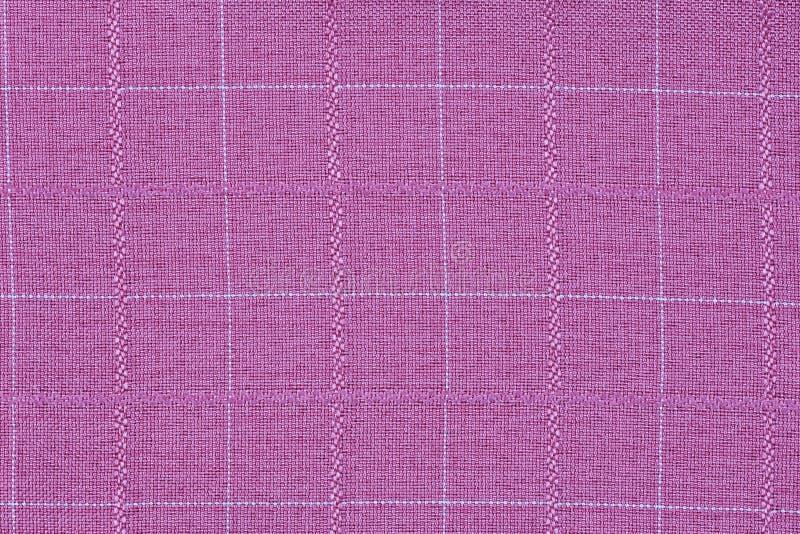Rosa Material in Gitter, ein Textilhintergrund stockfotos