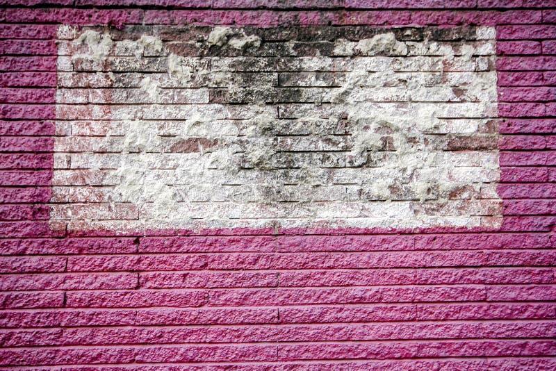 Rosa och vita tegelstenväggar arkivfoto