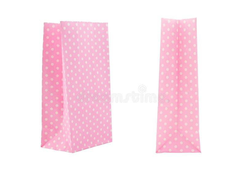 Rosa Papiertüte lokalisiert auf weißem Hintergrund lizenzfreie stockfotografie
