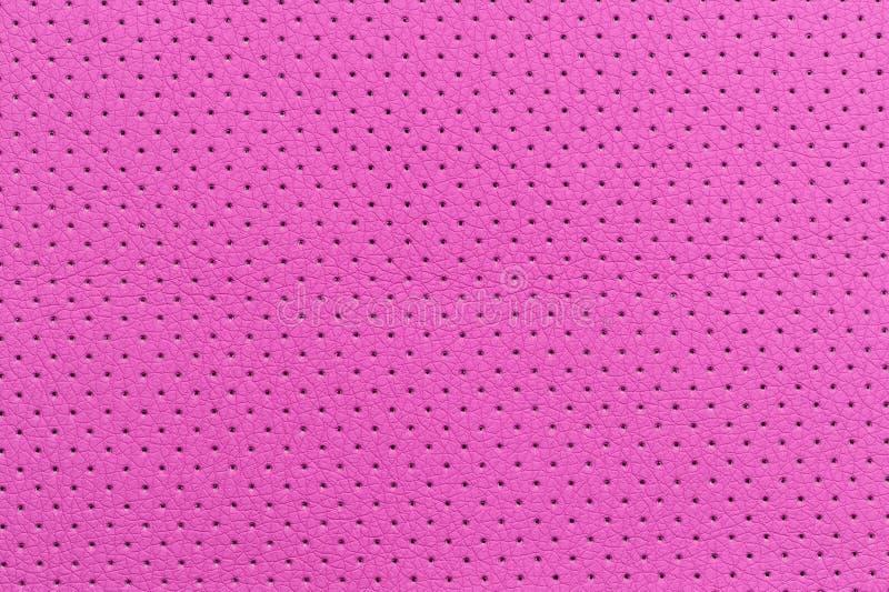 Rosa perforierte Kunstleder-Hintergrund-Beschaffenheit lizenzfreies stockfoto