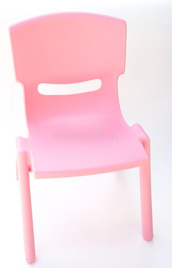 Rosa plast stol för barn fotografering för bildbyråer. Bild