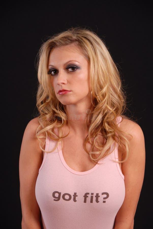 rosa posera sexig ärmlös tröja för blond jeans arkivfoto