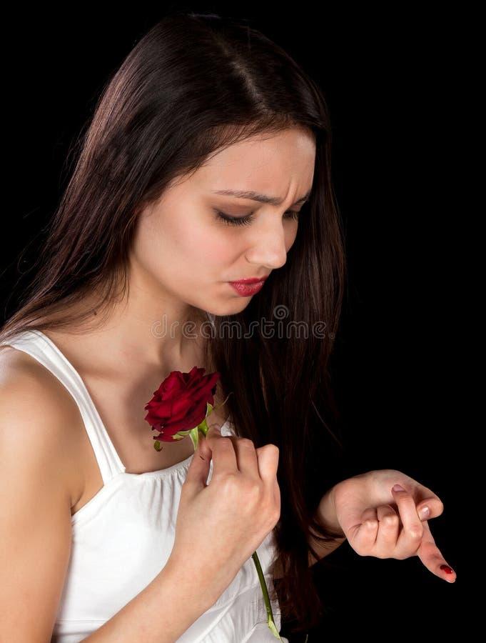 Rosa que pricking um dedo fotografia de stock royalty free