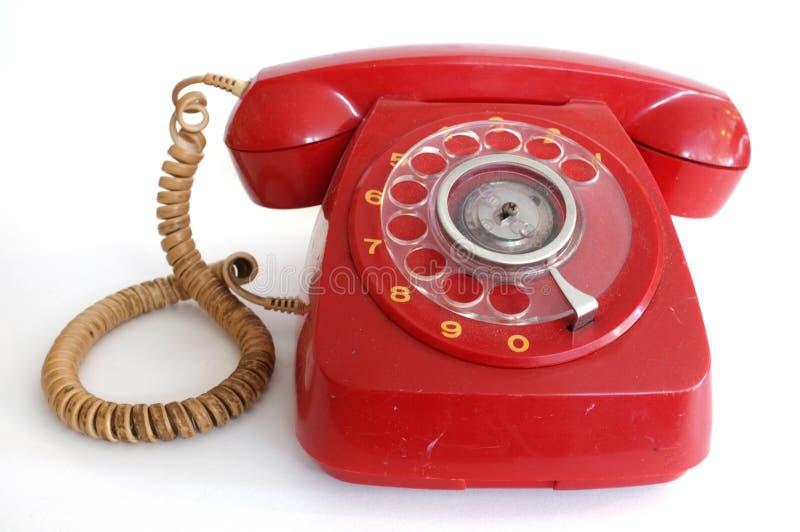 Rosa röd retro telefon för roterande visartavla royaltyfri fotografi