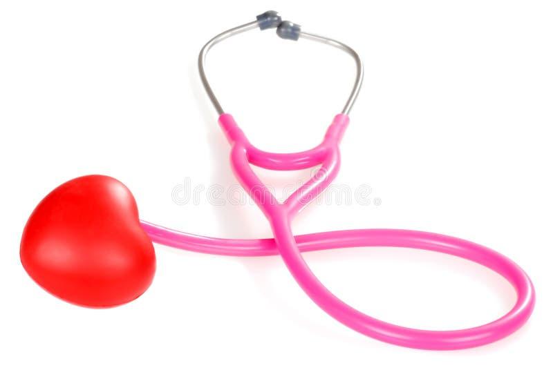 rosa rött stetoskop för hjärta royaltyfri bild