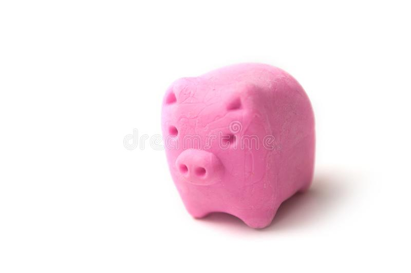 Rosa radering i formad piggbank - skuldsuddskoncept fotografering för bildbyråer
