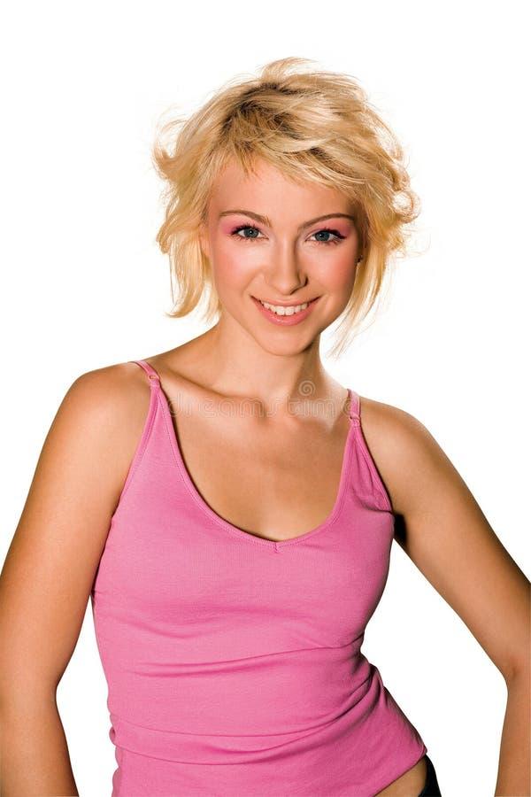 rosa skjorta som ler den teen kvinnan arkivbild