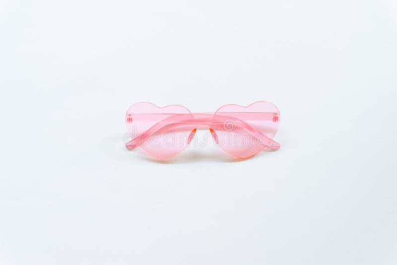Rosa Sonnenbrille auf wei?em Hintergrund lizenzfreie stockbilder