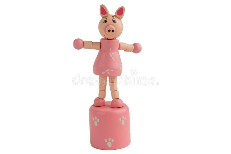 Rosa svin för träleksak Symbol av året 2019 isolate royaltyfri bild
