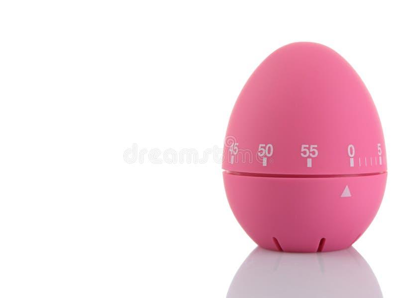 rosa tidmätare för ägg royaltyfria bilder