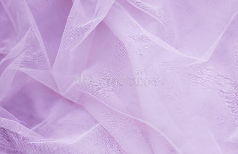 Rosa torkduk, brud- klänningbakgrund för luftig satäng Utrymme f?r text royaltyfri foto