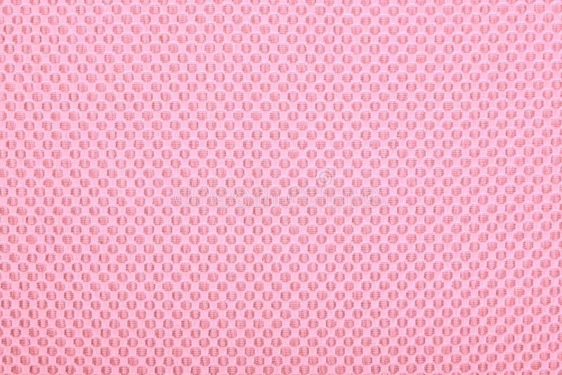 Rosa tyg med prickar, bakgrund. arkivfoton
