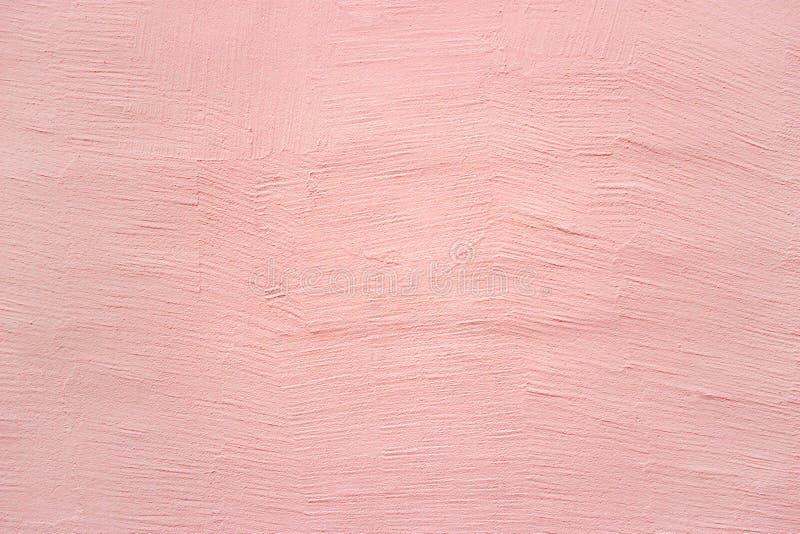 Rosa vägg, texturmurbruk, konkret yttersida som en bakgrund arkivfoto