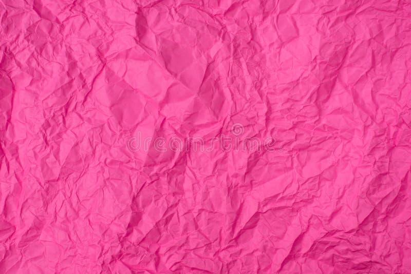 Rosa zerknitterte Papierbeschaffenheit als Hintergrund stockfoto