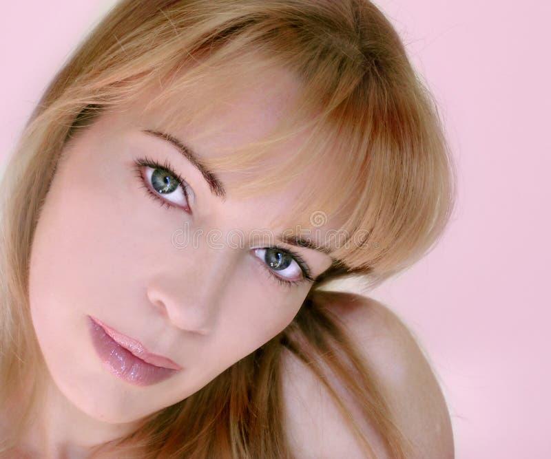 Rosafarbene Frau Stockfoto