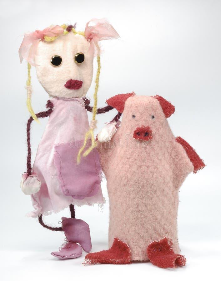 Rosafarbene Lappen-Puppe-Spielwaren stockbild