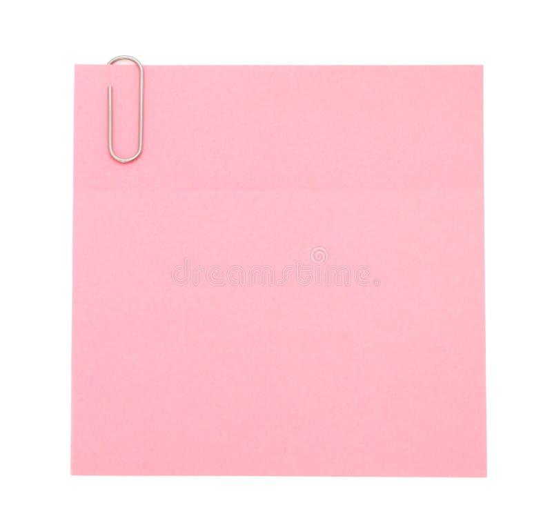 Rosafarbene Papieranmerkung mit Papierklammer lizenzfreies stockfoto