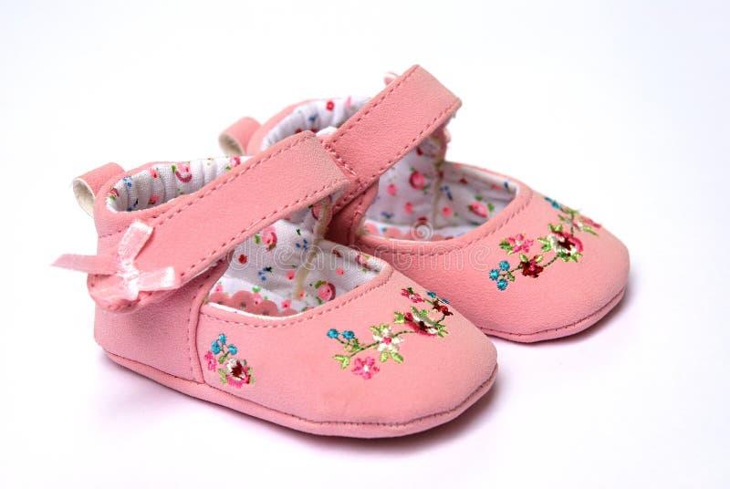 rosafarbene Schuhe für Schätzchen stockbilder